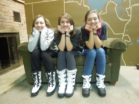 Three girls posing for the camera at H.S. Winter Retreat at Camp Friedenswald