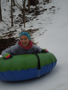 WInter Family Retreat fun tubing down the big hill at Camp Friedenswald
