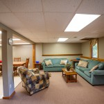 Sycamore Lodge main area couches at Camp Friedenswald