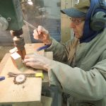 J.O. Augspurger assists with a woodworking project