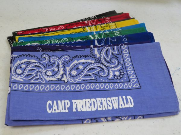 Camp Friedenswald bandanas arranged to show all available colors.