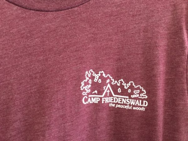 Camp Friedenswald T-shirt in maroon, with camp logo.