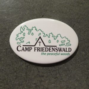Camp Friedenswald magnet in white with logo.