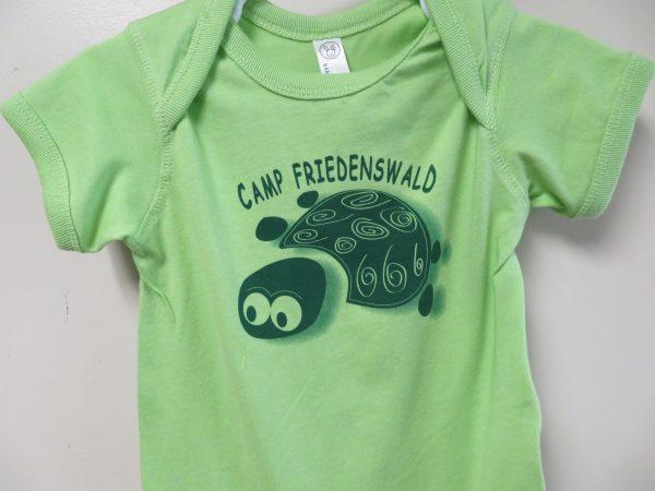 Camp Friedenswald onesie in green with turtle logo.